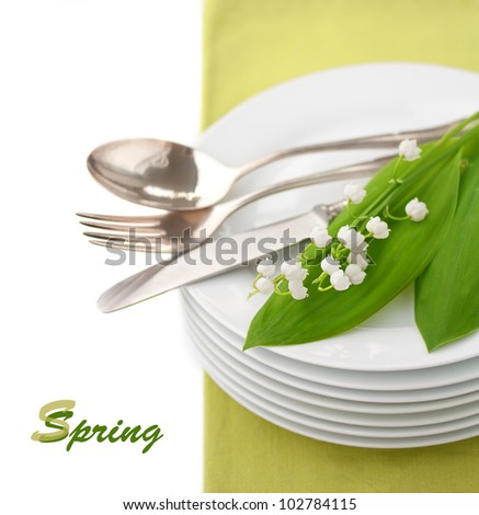 Tableware and Lily of the Valley - stock photo