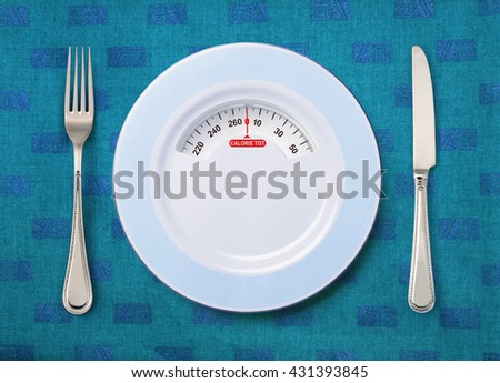 tableware and plate with weighing scale on the table - stock photo