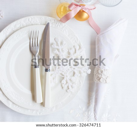 Tableware for christmas - set of white plates with decorations  and utensils  - stock photo