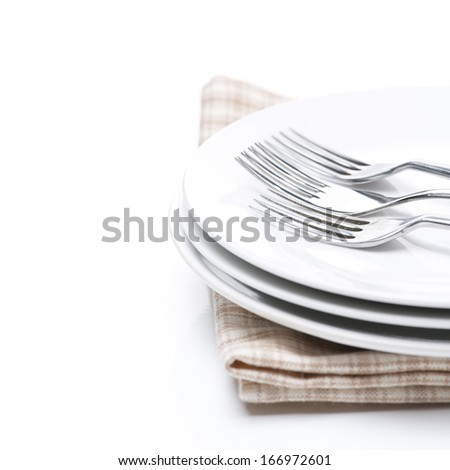 tableware for dinner - plates and forks, isolated, selective focus, close-up - stock photo