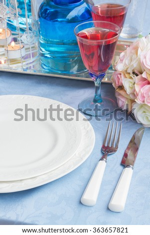 Tableware for valentines day with  plates, cutlery and champagne - stock photo