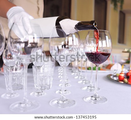 tableware, glasses of wine. pouring wine - stock photo