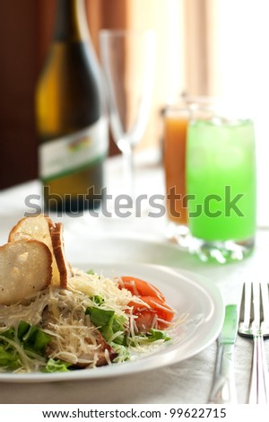 Tablewares and salad close up with a dim background