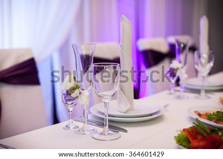 Tablewear and silverware closeup at wedding reception table elegant and minimalistic