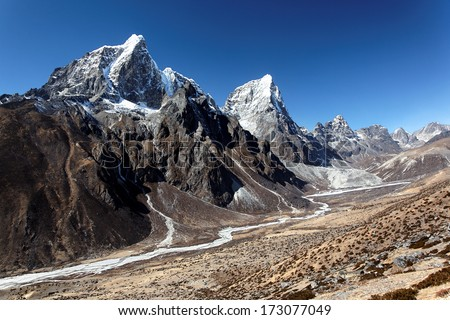 Taboche and Arakam Tse, two giant Himalayan peaks in the Mount Everest region of Nepal - stock photo