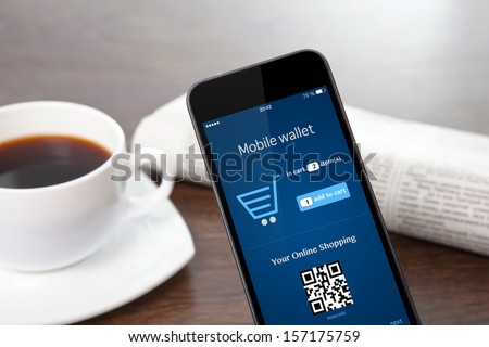 tach phone with mobile wallet onlain shopping on the screen on a table at a businessman in office - stock photo