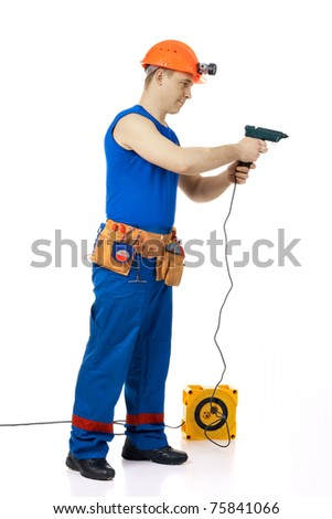 Tachnician man working class with equipment against white background - stock photo