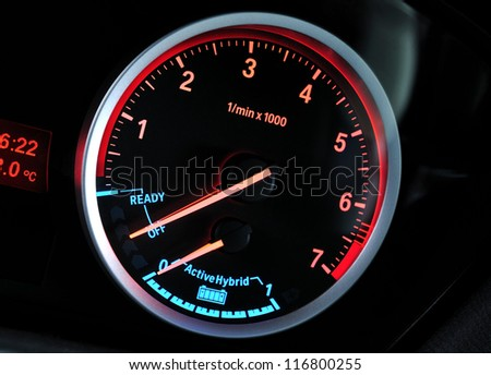 Tachometer and hybrid energy indicator - stock photo