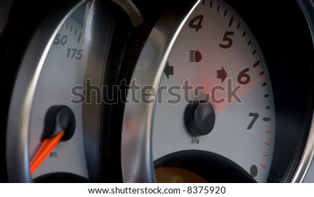 Tachometer and speedometer from a modern high performance automobile. - stock photo