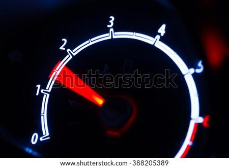Tachometer illuminated at night, motion look - stock photo