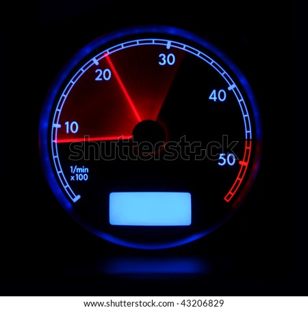 Tachometer in blue and red colors on black background
