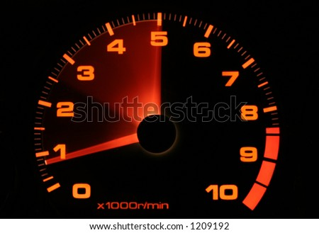 Tachometer needle with blur to indicate acceleration - stock photo