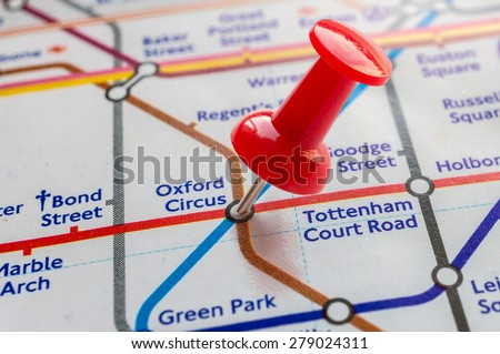 Tack on Oxford Circus tube station in london underground map - stock photo