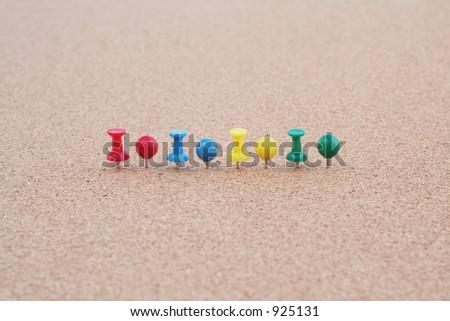 Tacks on Cork Board - stock photo