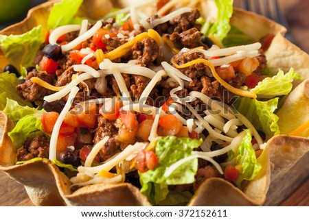 Taco Salad in a Tortilla Bowl with Beef Cheese and Lettuce - stock photo