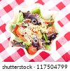 Taco salad on checkered tablecloth - stock photo