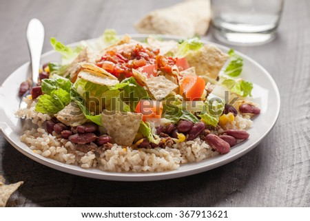 Taco Salad stacked on a bed of brown rice horizontal view - stock photo
