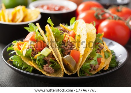 taco shells with beef and vegetables - stock photo