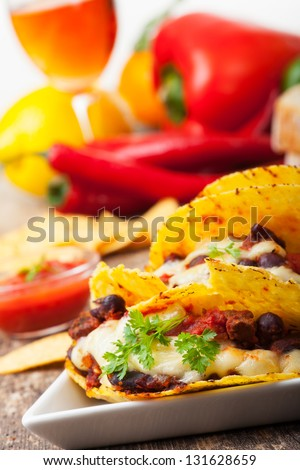 taco with chili con carne in a bowl - stock photo