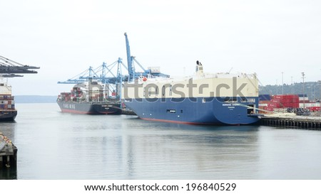 TACOMA, U.S.A - JUNE 04, 2014: EUKOR's Morning Cherry  arrives in the Port of Tacoma, Washington on her maiden voyage. EUKOR annually transports around 4 million cars worldwide. - stock photo