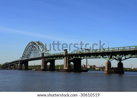 Tacony Palmyra steel bridge over the Delaware River connecting Philadelphia Pennsylvania to New Jersey - stock photo