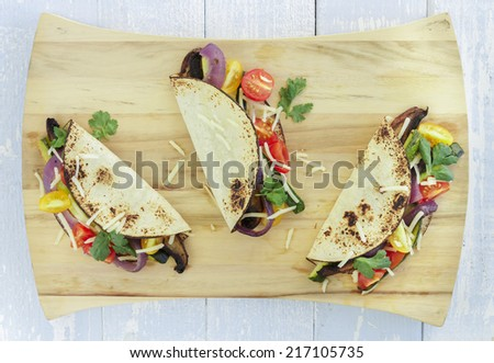Tacos filled with roasted portobello mushrooms, zucchini and purple ...