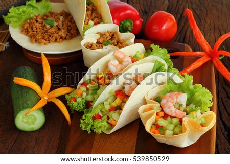 Tacos is Mexican food with shrimp.