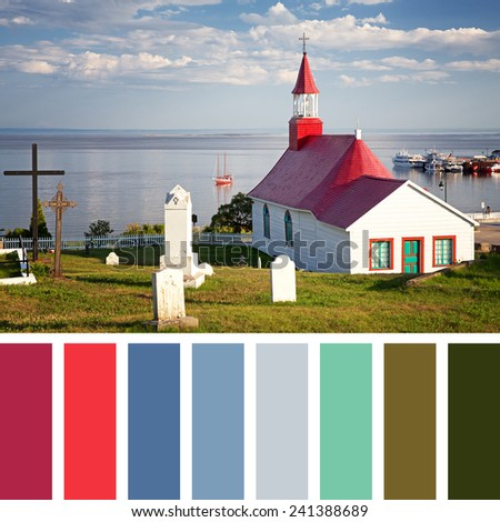 Tadoussac Chapel, overlooking the St Lawrence River, Quebec, Canada, with a palette of complimentary colour swatches. - stock photo