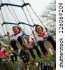 TAEDONG-SAN, NORTH KOREA - MAY 1: Unidentified local school children enjoy themselves at the Taedong-san (Mt Taedong) Funfair, near Pyongyang, during the May day celebrations on May 1, 2012. - stock photo