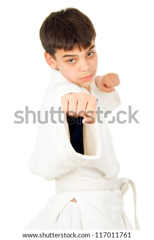 Taekwondo class boy isolated - stock photo