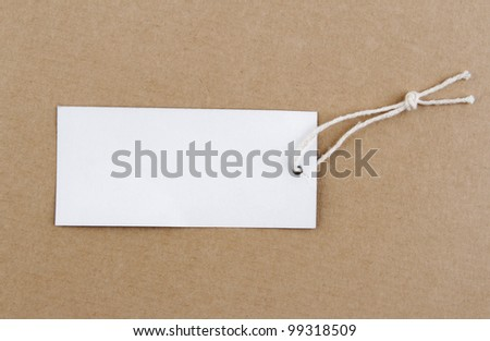 Tag and string on brown background