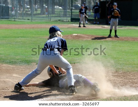 Tag Made At 3rd Base in a Baseball Game - stock photo