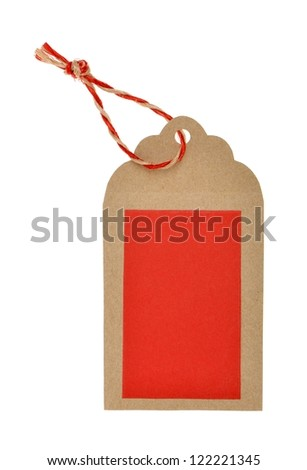 tag with red thread under brown background - stock photo