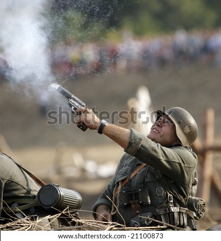 "TAGANROG, RUSSIA - AUGUST 30: A WWII historical military reenactor participates in a re-enactment of the ""Break of Mius-front 1943"" on August 30, 2008 in Taganrog, Russia."