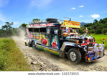 TAGBILARAN, PHILIPPINES-FEBRUARY 10: Jeepney. Jeepneys are public transport. They were originally made from US military jeeps left over from World War II on Febuary 10, 2013 in Tagbilaran,Philippines - stock photo