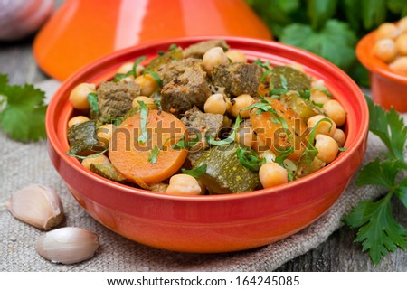 tagine with beef, vegetables and chickpeas, close-up, horizontal