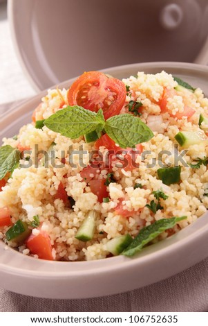 tagine with couscous and vegetables - stock photo
