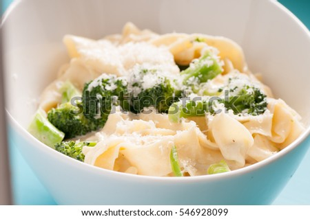 tagliatelle alfredo primavera, creamy sauce with vegetables and home made pasta