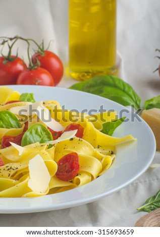 Tagliatelle in Italian colors, roasted tomatoes, basil and Parmesan