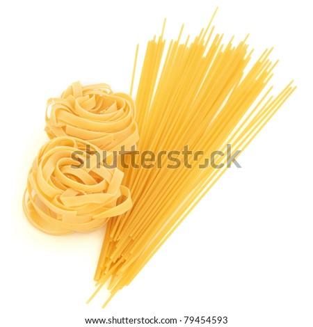 Tagliatelle pasta  and spaghetti isolated over white background. - stock photo