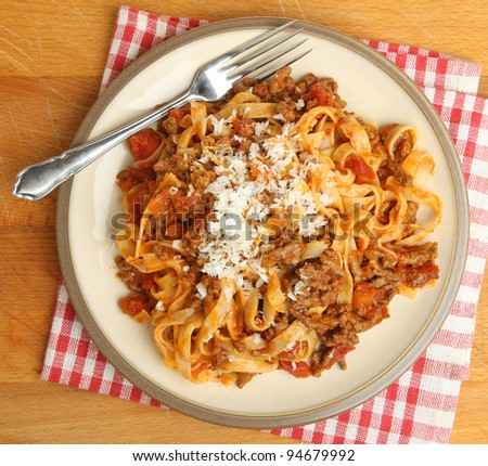 Tagliatelle pasta with bolognese sauce and Parmesan cheese