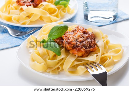 Tagliatelle pasta with meat bolognese sauce and cheese. Italian cuisine. - stock photo