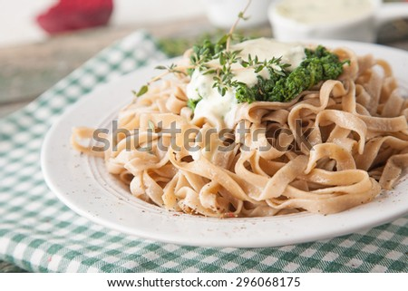 Tagliatelle pasta with spinach and fresh thyme