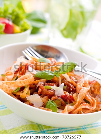 Tagliatelle pasta with tomato and vegetable sauce - stock photo