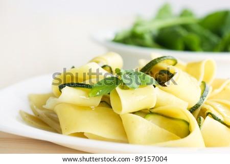 Tagliatelle pasta with zucchini, garlic and olive oil. - stock photo