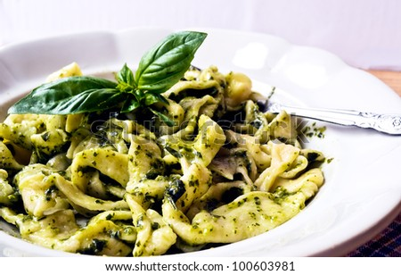 Tagliatelle poured homemade pesto from fresh basil and olive oil