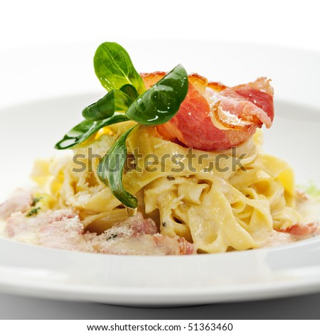 Tagliatelle with Carbonara Sauce and Bacon - stock photo