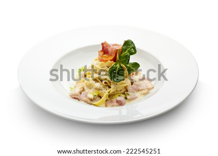 Tagliatelle with Carbonara Sauce, Bacon and Yolk of Quail Egg - stock ...