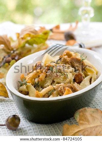 Tagliatelle with chanterelle, parmesan and thyme. Selective focus - stock photo