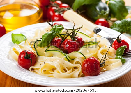 Tagliatelle with cherry tomatoes and zucchini - stock photo